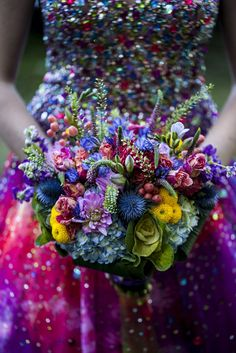 Sequined wedding dress + brightly colored bouquet = happy eyes