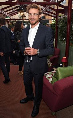 Studious Clubmaster-inspired specs take Simon Baker's already-dapper navy suit to a new level of masculine panache!
