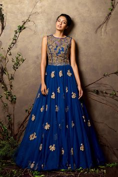 A turkish blue gown with a flare done in zardosi buttis.