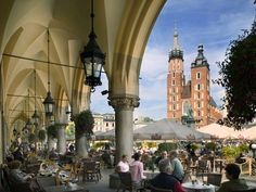 Café patrons enjoy a view of St. Mary's Church across Kraków's picturesque Rynek Główny, one of the largest public plazas in Europe. Dating to the 13th century and home to examples of Gothic and Renaissance architecture, the Old Town's market square is a popular shopping and dining destination for locals and tourists.    Photograph by Jon Hicks/Corbis