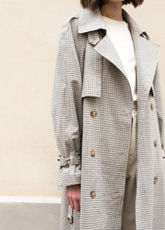 "#newarrivals #minihoundstooth #tan #multicolor #classic #trench #coat #cotton #thefrankieshop #frankienyc #frankiegirl Relaxed, Double Breasted Trench Coat w/Removable Matching Belt Shoulder Epaulettes & Adjustable Cuff Straps 2 Front Slanted Pockets. Front & Back Storm Flap, Back Vent Marble Button Closure. Fully Lined 95% Cotton, 5% Span Color- Beige/Black/Grey/Tan 44""Length, 45"" Bust 54"" Belt Length Dry Clean By Matilda Anotherleon. Imported"