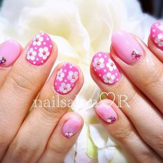 Instagram photo by rie_nail #nail #nails #nailart pink and white fingernail polish design with gem stones on top