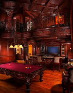 Love the way the bar sits in front of the tv and  pool table is behind. Then sitting area is on second story