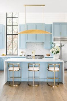 Wisteria Emerson Stools at a blue and white kitchen island with a white waterfall quartz feature. Home Decor Kitchen, Diy Kitchen, Kitchen Furniture, Kitchen Interior, Home Kitchens, Kitchen Design, Gold Kitchen, Remodeled Kitchens, Kitchen Ideas