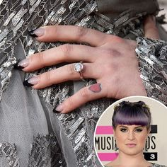 To go with her punk beauty look, Kelly Osbourne traded in her typical heart nail art for a graphic black take on a french manicure at the AMAs.