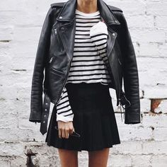 Leather jacket with a pleated mini skirt.