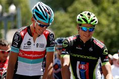 Andy Schleck of Luxembourg riding for Radioshack Leopard Trek talks with Peter Sagan of Slovokia and Team Cannondale prior to the start of stage one of the USA Pro Cycling Challenge on August 19, 2013 in Aspen, Colorado.
