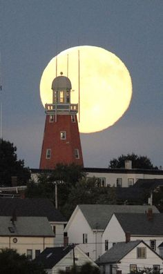 Doug Jones/Staff Photographer, Monday, September 15, 2008: Looks like a full moon, in this view from Back Bay of the city skyline of Munjoy Hill's,  Portland Observatory.