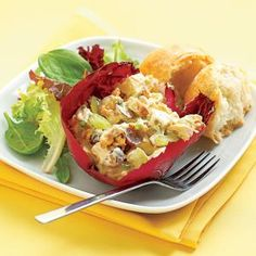 Spice up a plain chicken salad with curry powder and add grapes for sweetness and chopped walnuts for crunch. Serve the salad in radicchio cups for an elegant presentation.