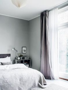 Renter-Friendly Window Treatment Ideas That Don't Damage Walls - Suspend Curtain Rods from the Ceiling