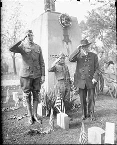 Civil War veteran salutes with a Boy Scout and a soldier at a gravesite in Oak Woods Cemetery, Chicago, Illinois, Decoration Day, 1927.  Photo: Chicago Daily News from Library of Congress, American Memory