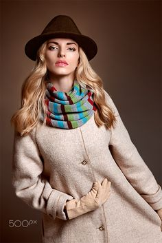 Fashion beauty woman in stylish coat hat, autumn - Fashion beauty woman in stylish long coat, hat. Autumn winter model blonde girl with long blonde wavy hair in colored striped scarf, gloves. Unusual creative attractive people. Retro Vintage,copyspace