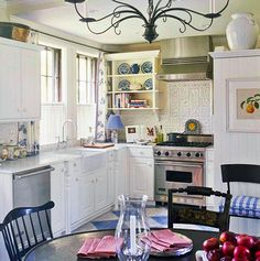 Beautiful, Efficient Small Kitchens - Traditional Home®, the sink, floor and double windows with farm sink offset