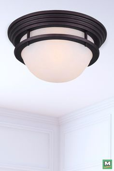 Patriot Lighting® Justin 11'' Flush Mount Light with Oil-Rubbed Bronze Finish and Flat Opal Glass.