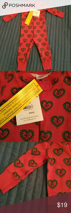 NWT Hanna Andersson Sleeper Pajamas Organic Soft and comfortable footless zip up sleeper pajamas by Hanna Andersson. Red with green hearts. Red trim and cuffs. 100% organic Peruvian cotton. New with tags attached. Retails for $38 I have one in size 60 cm or 6-9m and 1 in size 70 cm or 9-12 m US Hanna Andersson Pajamas