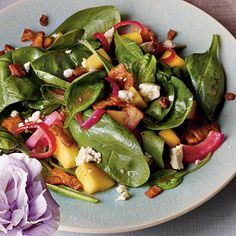 Mango-Spinach Salad with Bacon Vinaigrette   This is a delicious partner for grilled fish. Don't forget fresh crusty bread to soak up every bit of the warm vinaigrette.   SouthernLiving.com