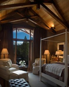 The 2007 HGTV Dream Home master bedroom offers an open sitting area inside and out, providing striking views of the Rocky Mountains. A mix of textures and a simple blend of creams and browns evoke a cozy cabin feel.