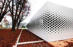 Format Elf Architekten added a pattern of hexagonal holes to the long aluminium facade of this office building in Germany to control the amount of daylight entering the interior