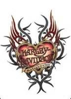 harley davidson tattoos for women. Love how it looks kind of tribal.