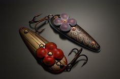 Decorative fishing lures comprised of Mokume-gane, vitreous enamels, copper, and commercial components.  Photo credit: Lauren McAdams