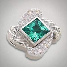 6x6 mm Square Topaz Evergreen accented with CZ's set in Sterling Silver Slide. All Sterling Silver is Rhodium plated. Metal:Sterling Silver Designer:Goldman-Kolber $ 150.00 Item #: HPRN2T Call 870-863-8818 for personal consultation.