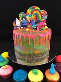 More Glitter!!! Drip cake - Trolls cake and matching cupcakes, with lollipops, edible glitter and figurines of Poppy, Branch and troll friends!