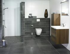 Bathroom: dark stone with wood and light walls