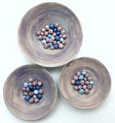 handmade beads in three bowls.