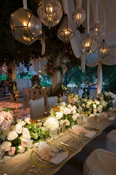 Hanging lights cast a magical glow over an elaborately  decorated table...