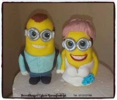Fondant minion wedding cake topper. For more info & orders, email SweetArtBfn@gmail.com or call 0712127786 Wedding Cake Toppers, Cupcake Toppers, Cupcake Cakes, Fondant Minions, Edible Cake, Preserves, Icing, Period, Cake Decorating