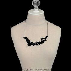 Cloud of Bats Necklace - Laser Cut Necklace (C.A.B. Fayre Original Design). $26.00, via Etsy.