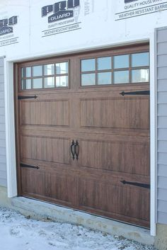 Garage doors that look like barn doors. Very easy DIY with paint and accessories.