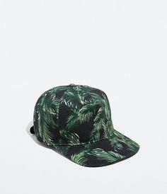 Muted palm tree leaves. PRINTED CAP from Zara.