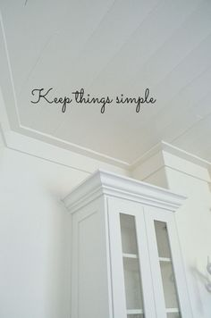 Crown molding above cabinets. I think this is what we will do throughout the entire house. Like how simple it is