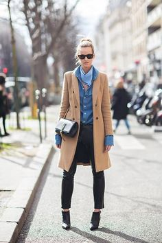 street style - camel coat worn with a chambray shirt, blue handkerchief scarf, leather pants, ankle boots + YSL chain tassel bag