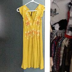 Floral Painted Accent Dress Paper thin soft olive green sun dress/top. Can be worn either way with leggings, boots or sandals. Ruffle shoulder sleeve, fits like a tank top dress. Floral print has beautiful painted accents. Bought at a boutique in Durango, CO. NOT FREE PEOPLE BRAND <listed for exposure> Free People Dresses Midi