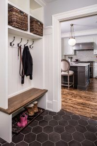 """Mudroom. Small Mudroom. Small mudroom dimensions and flooring. The mudroom bench top is 1 1/4"""" thick. The side walls of the cubbies are 1 1/2"""" but made from 3/4"""" wood. The back is 3/4"""" V-groove with a custom width. The large hex floor tile is SomerTile Textilis Hex Porcelain Floor and Wall Tile, Black. #mudroom #hexflooring #largehextile #mudrooms #smallmudroom Quartersawn Design Build"""