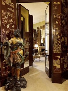 Coco Chanel's apartment above the Chanel boutique ~ French style with oriental styling, Victorian opulence and Russian coloring -- lots of cream, black, maroon and splashes of warm gold (2nd of five pins)