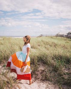Wind blown in a rainbow of color. My love of stripes continues with @mdsstripes over on galmeetsglam.com today (link in profile) #stripesforever #mdsstripes #ootd #beachbound #rainbowofcolors #seaandgrass