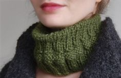 This ribbed neck warmer was hand-knit using a thick, oh-so-soft alpaca yarn. The simple yet graphic knitting technique and chunky yarn make for a chic, classic piece.  Can be worn around the head as well as the neck (see photo) and the all natural, soft fibers used for this piece are so cozy and warm, you'll want to live in it.