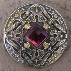 Gorgeous antique Gay 90's large ornate brass button with reddish glass jewel set in the center.
