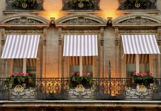 Haute Design1 Striped Awnings. I would love to have striped awnings on my own home.