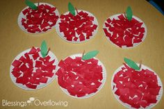 Apple Activities.   Paper place apple tissue paper.   Color: Red Shape: Circle  Letter: A