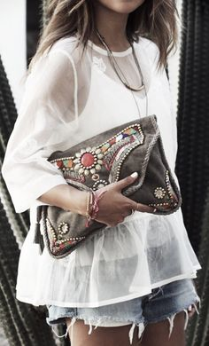 bohemian white blouse, suede beaded clutch and distressed jeans shorts. Casual afternoon outfit
