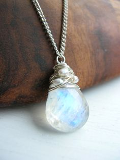 A truly beautiful Moonstone Necklace. AA Grade Large Moonstone briolette, which is a stunning translucent white with a dancing blue fire. Intricately woven with small but sumptuous fresh water pearls. Chain with chain extender. Cute Jewelry, Jewelry Accessories, Jewelry Necklaces, Jewelry Design, Gold Jewellery, Owl Jewelry, Silver Necklaces, Moonstone Necklace, Moonstone Pendant