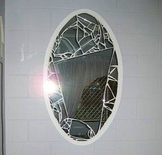 Broken mirror pieced together with large unbroken center. Any shape