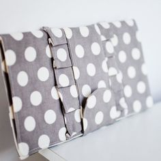 foldover ruffle clutch in gray polka dots