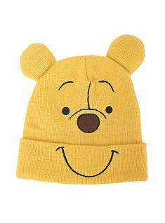 59f21cbe73c Cosplay style knit watchman beanie from Disney s Winnie The Pooh with an  embroidered Pooh face   attached padded ears.