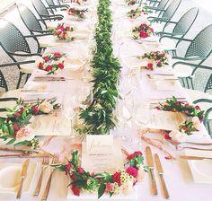Floral half wreaths for head table.