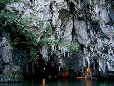 """Dragon's Mouth   Longgong Cave (龍宮: """"Dragon Palace"""") - The cave is situated above sea level and one has to walk 200 meters upwards to reach it. From there one can sail into the cave and experience the stalagmites and stalactites of the karst formation. There is also a waterfall by the foot of the cave"""